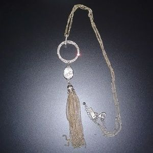 INC gold long necklace with a tassel